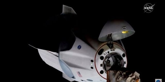 SpaceX spacecraft docks with International Space Station on historic NASA mission