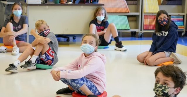 A Group Of Parents Sent Their Kids' Face Masks to A Lab for Analysis. Here's What They Found